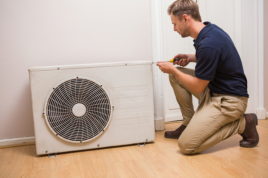 Man fixing HVAC system for home