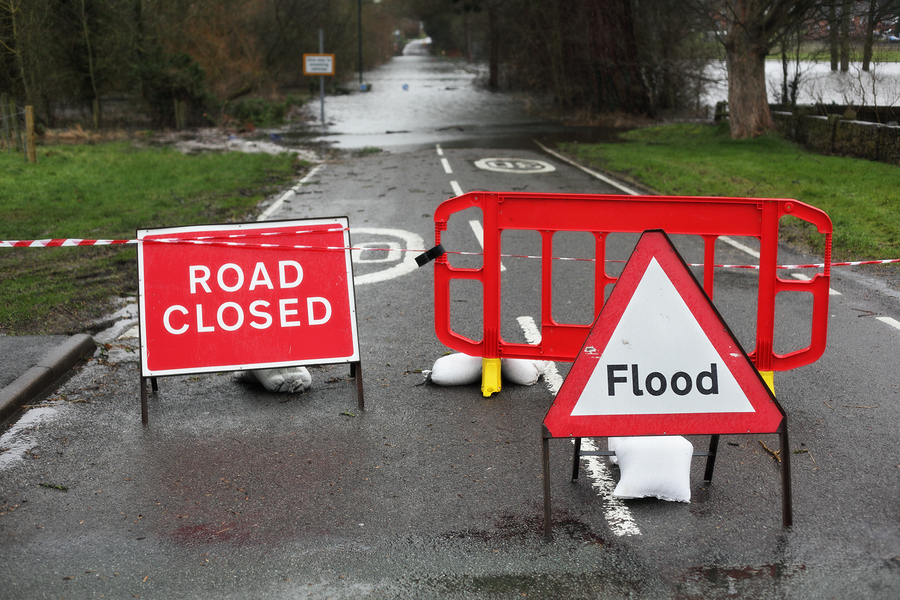 Road warning signs of flood